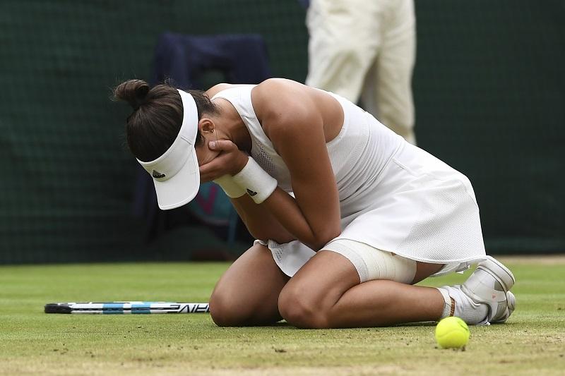 Garbine Muguruza breaks down for an emotional Wimbledon title win. Photo: Glyn Kirk/AFP.