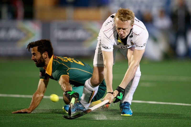 Jethro Eustice stumbles as he tries to stop another Belgian attack. Photo: Jan Kruger/Getty Images for FIH.