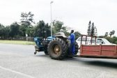 WATCH: Tractor without front wheel owns the road