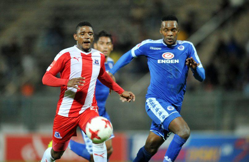 Mohau Mokate of Maritzburg United challenged by Morgan Gould of Supersport United at Lucas Moripe Stadium. (Muzi Ntombela/BackpagePix)