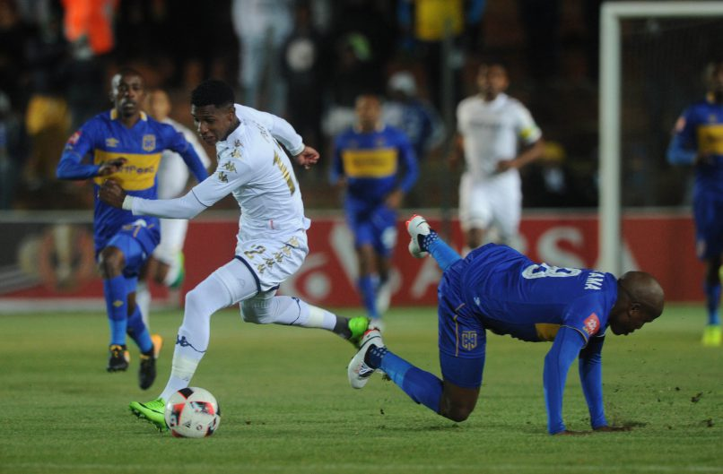 Lebogang Manyama of Cape Town City tackles Vincent Pule of Bidvest Wits during the Absa Premiership match between Bidvest Wits and Cape Town City. ( Sydney Mahlangu /BackpagePix)