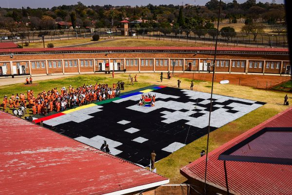 Inmates and prison warden's are seen on a section of the Mandela Masterpiece, which is a gaint face of Nelson Mandela made up entirely of crocheted blankets at the Zonderwater Correctional Centre, 11 August 2017, Cullinan. Picture: Jacques Nelles