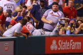 WATCH: Baseballer dives into fans as the nachos flies!