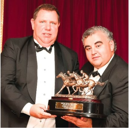 TOP AWARD. Trainer Alan Greeff (left) receives the trophy from Clyde Basel for Clear Sailing who among other awards, was named Horse Of The Year in the Eastern Cape. Picture: Pauline Herman