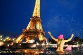 Surfing the Seine: climate campaigner paddles in Paris