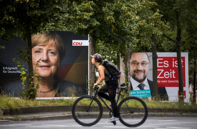 Polls show German Chancellor Angela Merkel heading for victory over Social Democratic rival Martin Schulz as both make a final campaign push -- but also the hard-right Alternative for Germany winning around 60 seats