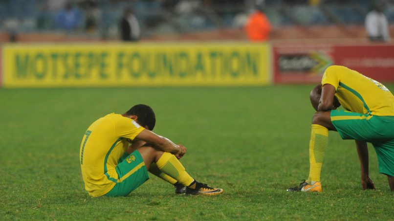 Keegan Dolly and Ramahlwe Mphahlele of South Africa dejected after the final whistle    during the World Cup Qualifier match between South Africa and Cape Verde at Moses Mabhida Stadium. (Sydney Mahlangu /BackpagePix)