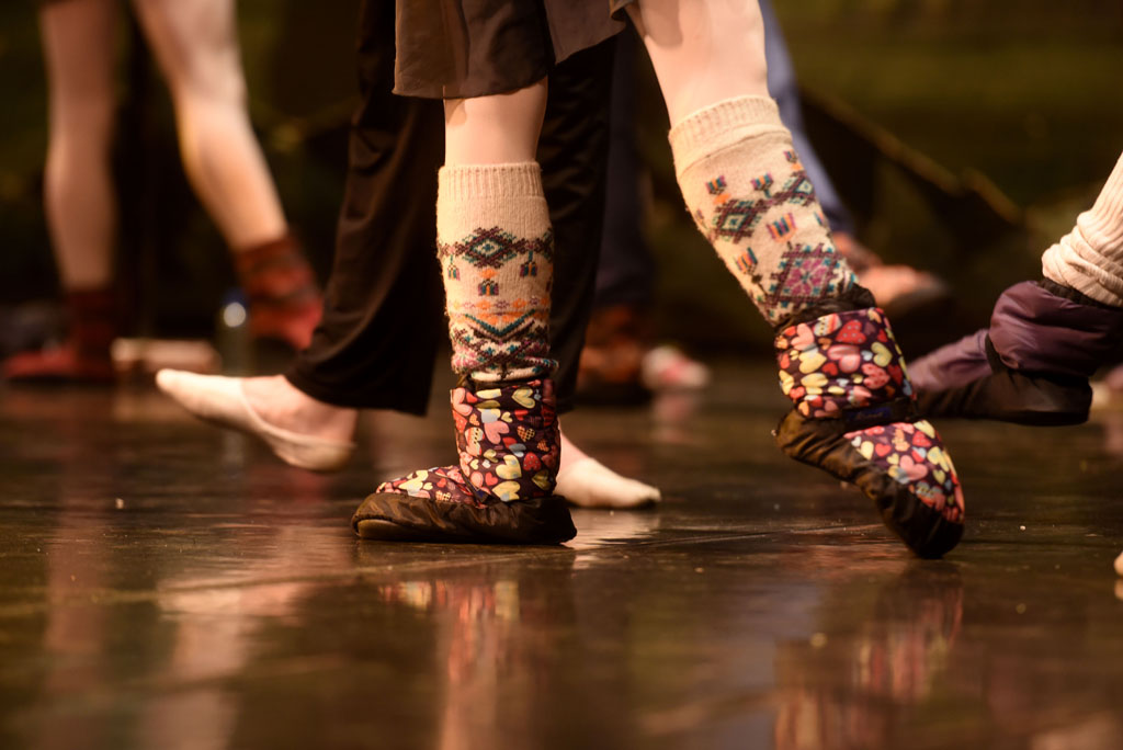 A ballet dancer keeps her feet warm while getting ready for a performance of Swan Lake. Picture: Tracy Lee Stark