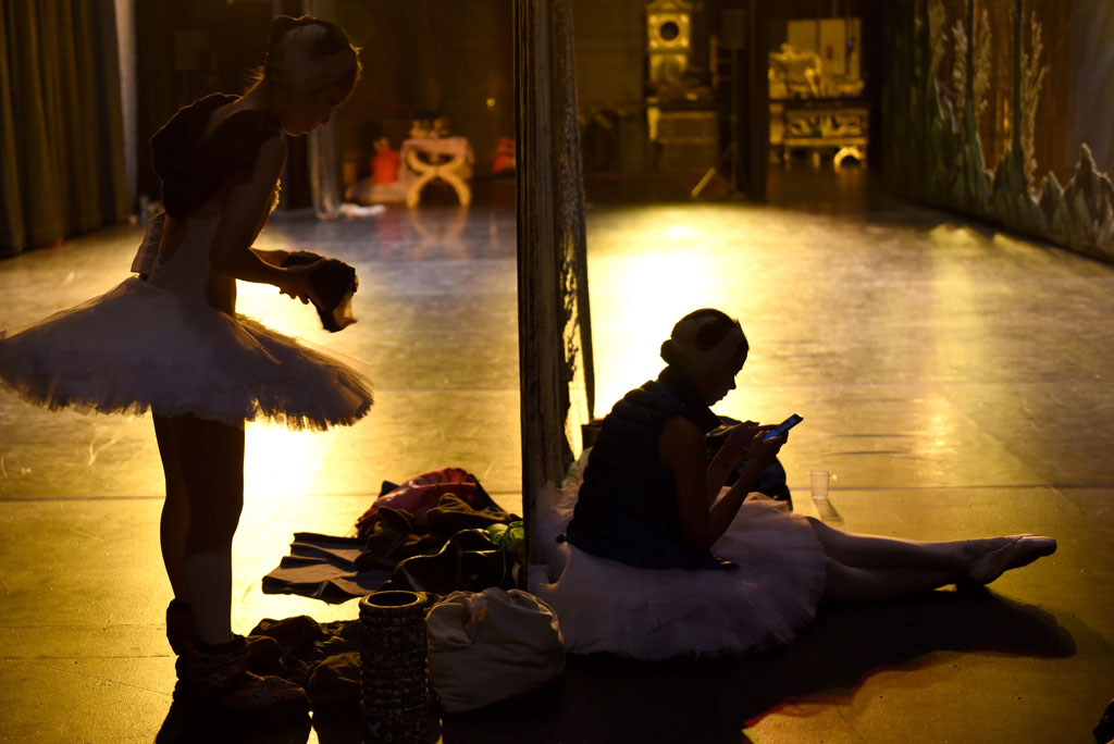 Ballerinas get get ready to leave the stage after of a performance of Swan Lake. Picture: Tracy Lee Stark