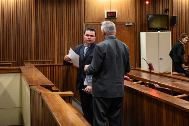 Schalk Myburgh Junior speaks to his father, Schalk Myburg Senior, after the court adjourned for the day in the Pretoria High Court, 7 September 2017, Pretoria. The father and his son stand accused of murdering a black farmer with their bare hands before driving over him on a farm near Brits. Picture: Jacques Nelles