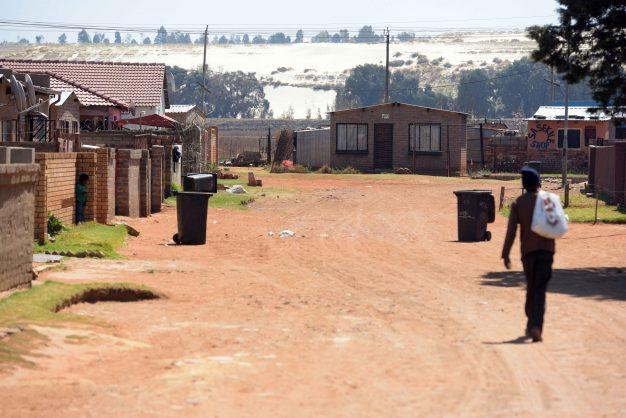 Mine Dump behind a community in Snake Park.  Image by Nigel Sibanda