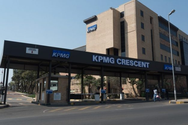 Pedestrians walk past the KPMG Offices on Empire Road in Johannesburg on 15 September 2017.