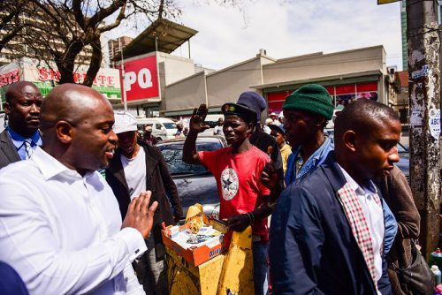 Tshwane Mayor Solly Msimanga is seen greeting a passer-by during an outing to speak with informal traders in the CBD, 5 September 2017, Pretoria. Picture: Jacques Nelles