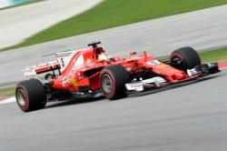 Vettel wins nail-biting race