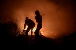 Rain, winds help tame wildfires in Spain and Portugal