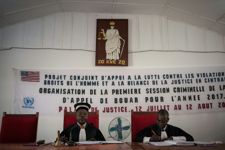 Wheels of justice: The prosecutor and president of Bouar's High Court take their seats