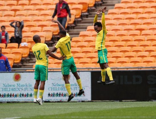 Percy Tau of South Africa (r) celebrates goal with Themba Zwane (c) and Kamohelo Mokotjo (l. (Gavin Barker/BackpagePix)