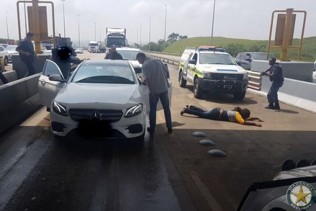 Police confront the car thief at the Tongaat Toll Plaza
