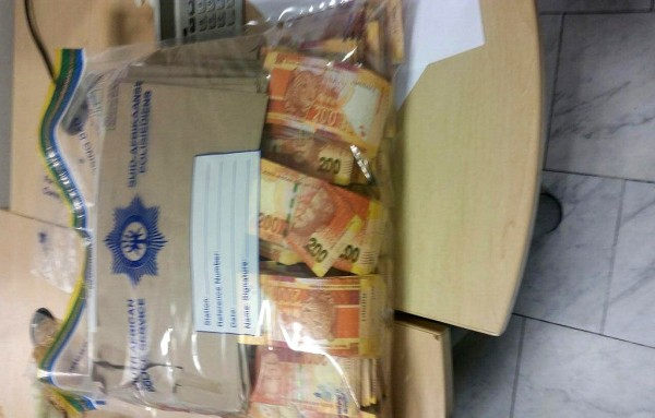 Image of a bag of money that was seized at Cape Town International airport. Photo: ANA / Supplied by Hawks