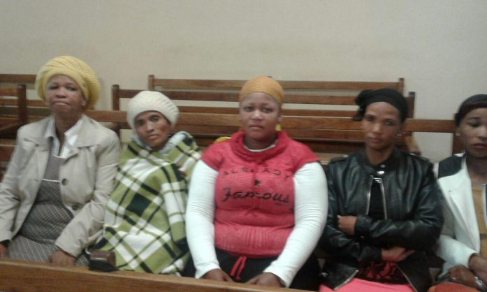 Caption: Spencer Tshukudu's mother Dorah Tshukudu, second from left, supported by family members in court during the bail application of Jaco du Plooy on Thursday. Photo / ANA