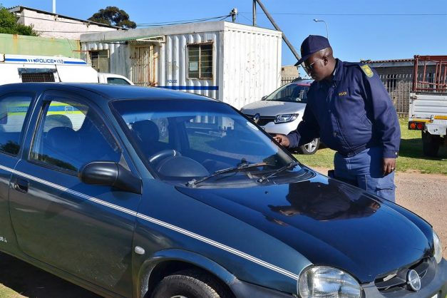 Constable Thobani Kumkani of the KwaNonqaba Police Station with the Opel Corsa a suspect was driving. Photo: Nickey le Roux