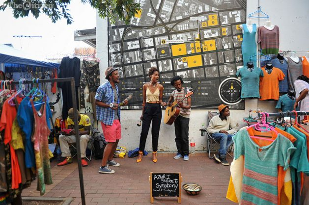 The Azuri Street Symphony, made up of, from left, Jermaine Burts, Teboho Ngakane and Hloni Kutu, perform outside Market On Main, in the Maboneng precinct, 12 March 2017. The group performs here every Sunday earning R300 to R400 per day. They perform in various parts of Johannesburg including at taxi ranks and outside the Johannesburg Library. Picture: Michel Bega
