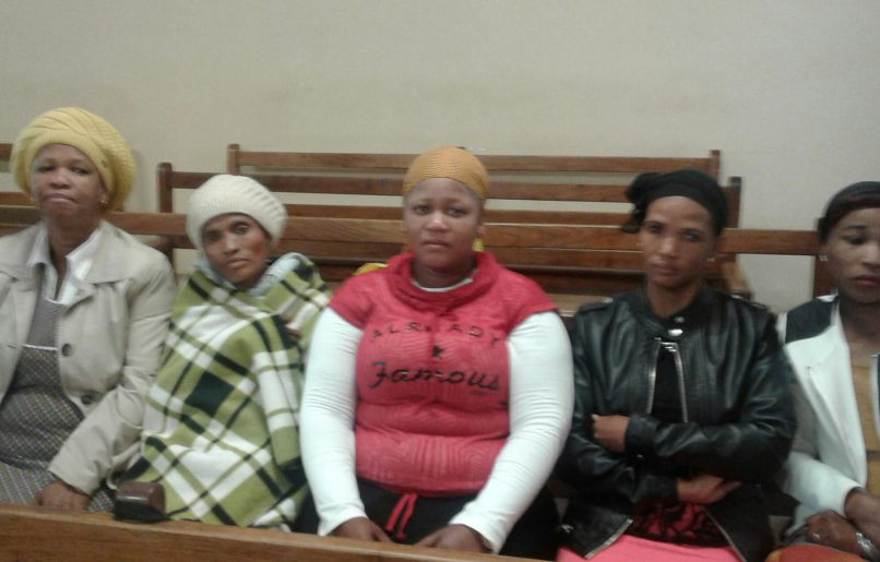 Slain Blydeville teenager Spencer Tshukudu's family at the Lichtenburg Magistrate's Court on October 12. The case was postponed to October 19 for a ruling on the accused's bail application. From left to right: Elsie Marope (aunt) Dorah Tshukudu (mother), Elisa Marope (cousin), and his aunts Rebecca and Susan Tshukudu.