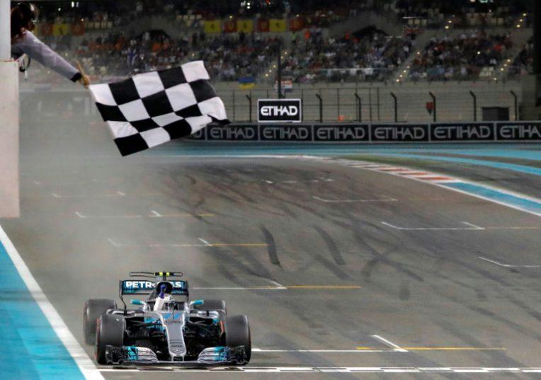 Mercedes' Finnish driver Valtteri Bottas crosses the finish line during the Abu Dhabi Formula One Grand Prix at the Yas Marina circuit on November 26, 2017