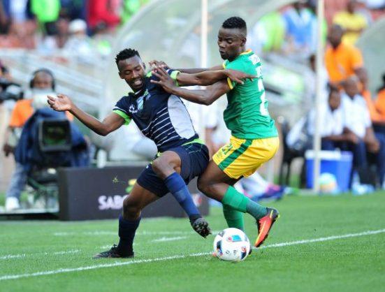 Siphiwe Mnguni of Platinum Stars challenged by Sipho Moeti of Baroka FC (Samuel Shivambu/Backpagepix)