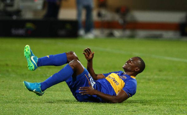 Victor Obinna of Cape Town City reacts in pain after injury during the Absa Premiership match between Cape Town City FC and Free State Stars at Athlone Stadium (Chris Ricco/BackpagePix)