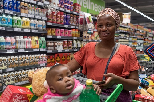 Milicent Maswanganye and her son Xivuriso queue on Black Friday at the Checkers store in the Mall of Africa in Midrand on 24 November 2017. Picture: Yeshiel Panchia
