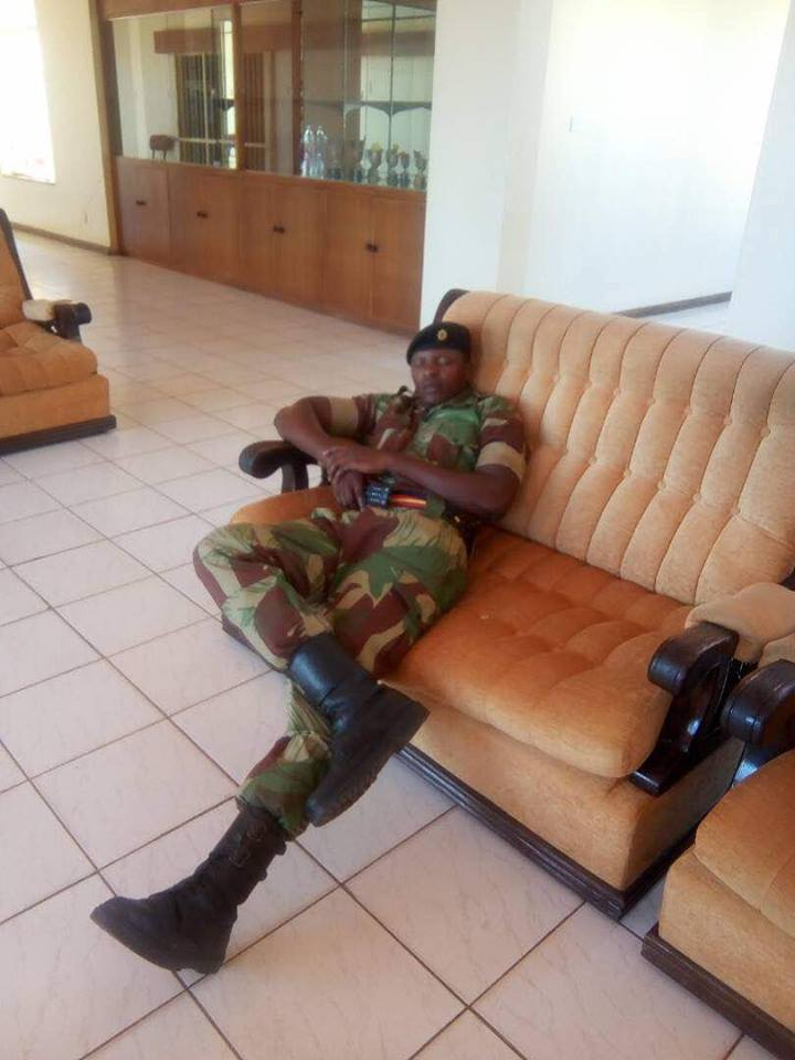 A soldier catches a nap inside the ''Blue Roof', 15 November. Facebook.