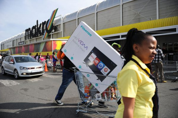A shopper walks away with a big-screen TV as shoppers take advantage of Black Friday specials, 24 November 2017, at the Makro store in Strubens Valley in Roodepoort. Picture: Michel Bega