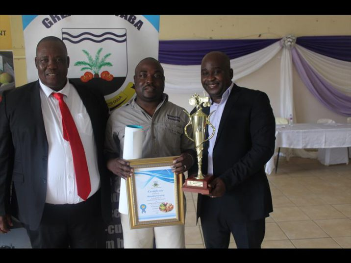 OVERALL WINNER: The Mayor of Greater Letaba Municipality, Peter Matlou, overall Best Agricultural Entrepreneur Award winner Tshwarelo Masutha of Masuhla Farming and the deputy director in the Department of Agriculture and Rural Development,Masaka Mabilu during the award ceremony at Kgapane Community Hall on Friday.