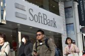 SoftBank seals deal for large Uber stake, trimming valuation