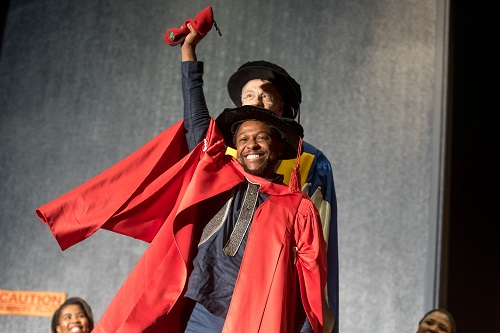 Economic Freedom Fighters (EFF) spokesperson Mbuyiseni Ndlozi celebrates during his graduation ceremony in the Great Hall of Wits University on 5 December 2017. EFF members were there to celebrate the graduation of Ndlozi as a Doctor of Philosophy in Politics. Picture: Yeshiel Panchia