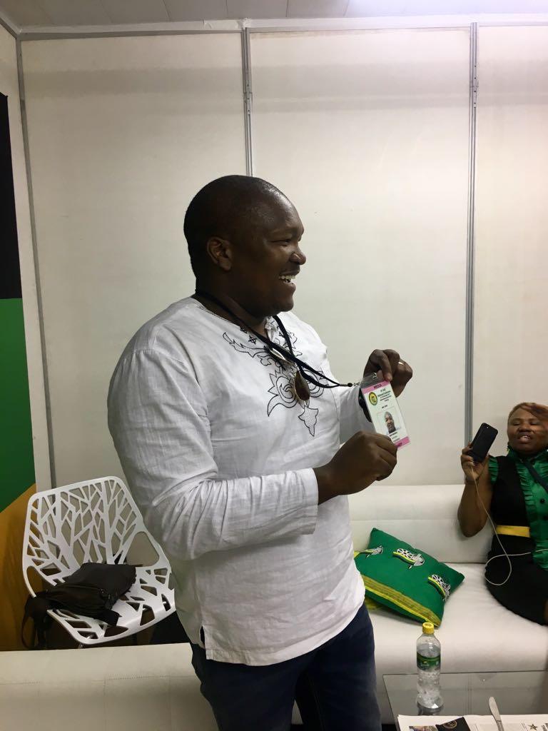 Sam Mkhokheli displaying his repatriated accreditation in the media lounge at Nasrec.