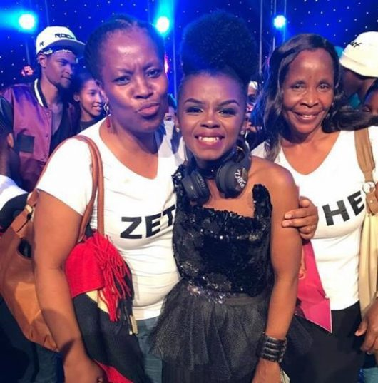 Zethe (middle) with her family