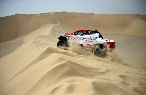 Toyota's driver Giniel De Villiers of South Africa and his co-driver Dirk Von Zitzewitz. / AFP PHOTO / FRANCK FIFE