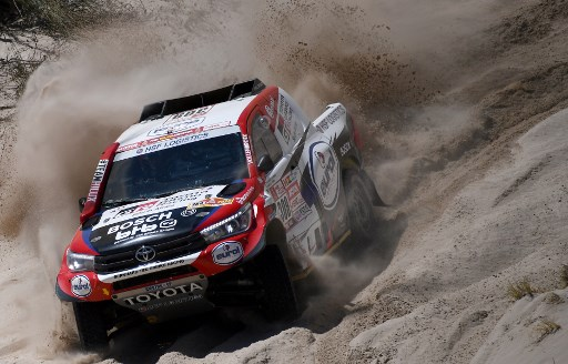 Dutch driver Bernhard ten Brinke with his co-driver Michel Perin of France steers his Toyota during the Stage 10 of the Dakar 2018 between Salta and Belen, Argentina.   / AFP PHOTO / FRANCK FIFE