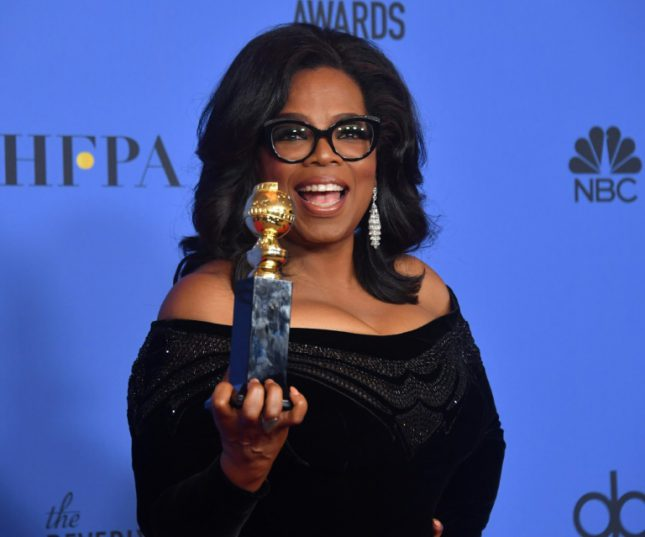 Actress and TV talk show host Oprah Winfrey, seen here posing with the Cecil B DeMille Award during the Golden Globe Awards on Sunday, delivered a rousing speech that has Democrats talking about her running for president in 2020