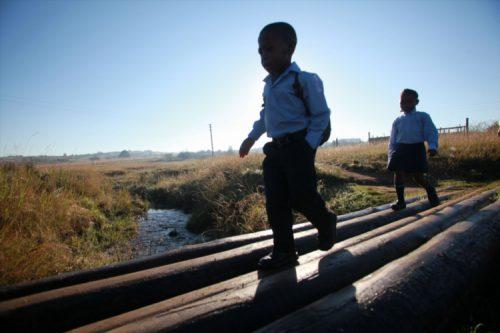 FILE PICTURE: Children on their way to school. (Photo by Gallo / Sowetan / Johnny Onverwacht)
