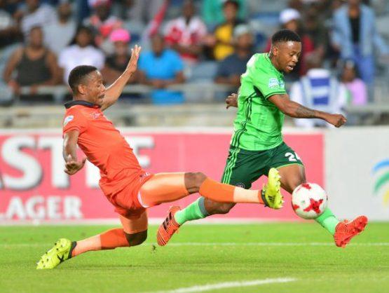 Thabiso Kutumela of Orlando Pirates tackled by Thabiso Semenya of Polokwane City. (Samuel Shivambu/BackpagePix)