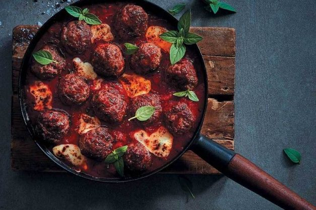 Herbed meatballs in tomato sauce with melty mozzarella.