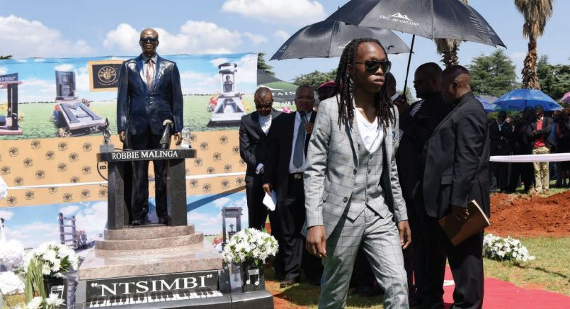 IMMORTALISED. Robbie Malinga's son, Robbie jnr, walks back to his seat after unveiling his father's tombstone and reading the inscription at the Westpark Cemetery in Johannesburg, yesterday. Pictures: Refilwe Modise