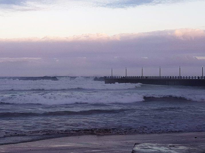Waves wash girl (7) off pier