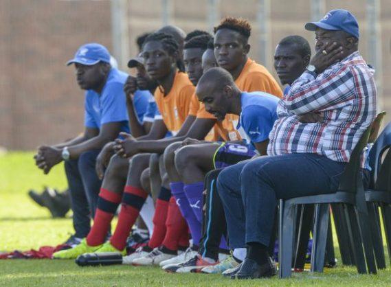Coach Ephraim Jomo Sono with his bench (Photo by Sydney Seshibedi/Gallo Images)