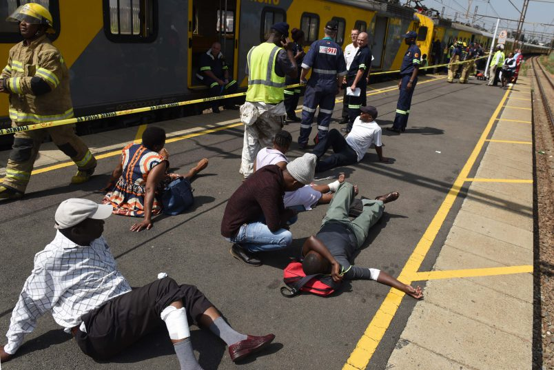 Injured passengers on the platform as they are being attended to by paramedics after a train collided with another at Geldenhuis Station in Germiston, 9 January 2017. 226 people were injured when it hit another stationary train at about 7:15 in the morning.Picture: Neil McCartney