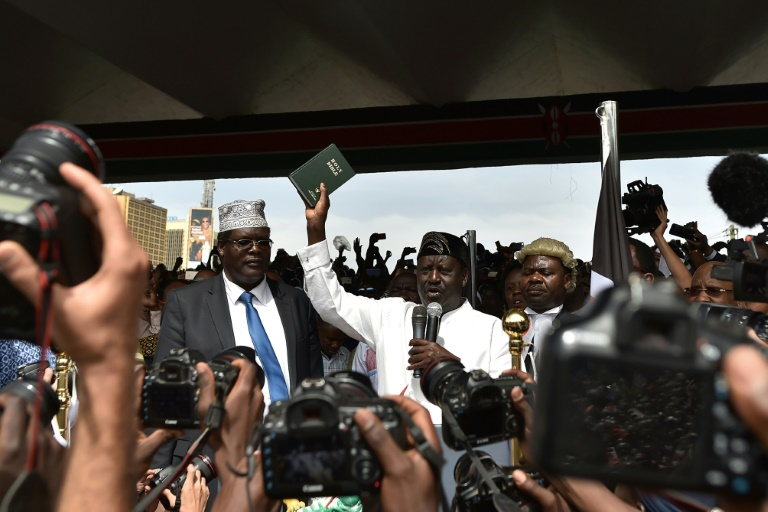 Three of Kenya's main private TV channels had their live feeds cut or blocked while covering the mock swearing in of opposition leader Raila Odinga