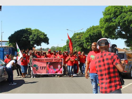 EFF members protesting outside the Krugersdorp Magistrates' Court after hearing that the accused would be released on bail. Photo: Bianca Pindral.